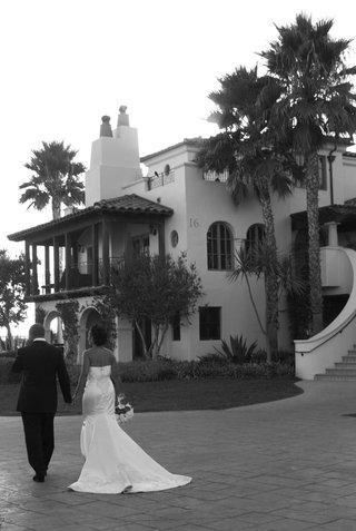 bride-and-groom-walk-towards-bacara-resort-spa