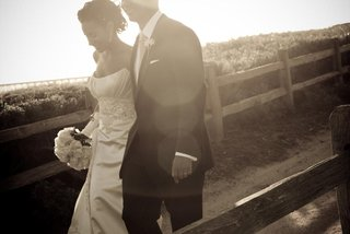 bride-and-groom-walk-along-oceanfront-trail