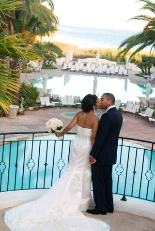 bride-and-groom-kiss-above-hotel-pool