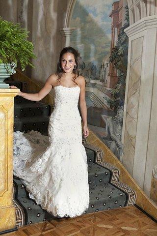 bride-walking-down-the-pierre-stairs-in-wedding-dress