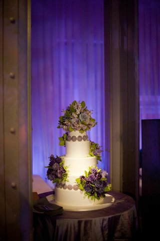 white-wedding-cake-with-purple-flowers-made-of-sugar