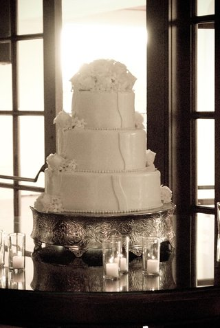 three-tier-wedding-cake-on-silver-cake-stand