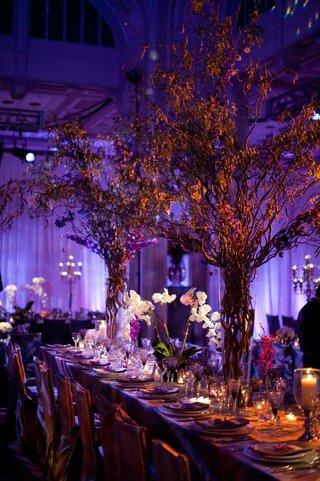 purple-lighting-at-wedding-reception-with-branch-flower-arrangements