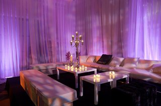 purple-lighting-at-wedding-reception-lounge-with-candlestick-decoration