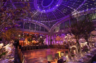 indoor-wedding-reception-with-vaulted-ceiling-and-opulent-decorations
