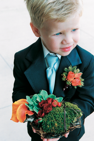 blonde-ring-bearer-wearing-blue-tie-and-orange-boutonniere-carrying-flower-basket