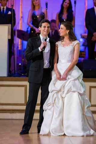 bride-in-a-monique-lhuillier-gown-with-a-lace-bodice-and-pick-up-skirt-with-groom-in-a-black-tuxedo