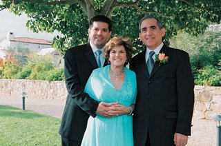 groom-hugs-mom-standing-next-to-dad