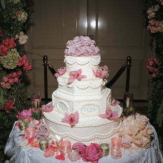 monogrammed-wedding-cake-with-pink-flowers-on-sides-and-top