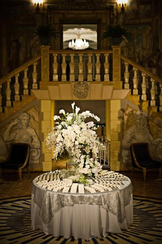 white-floral-arrangements-on-seating-card-table