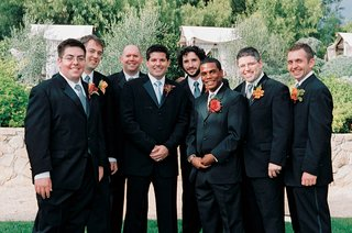 groomsmen-wearing-blue-ties-and-orange-boutonniers