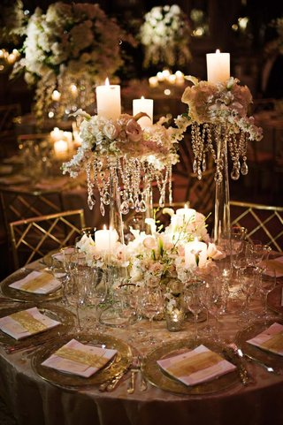 pillar-candles-and-flowers-atop-glass-vases