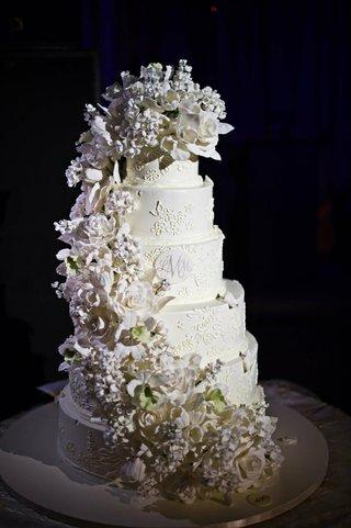 white-round-cake-with-monogram-and-sugar-flower