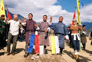 bride-and-groom-in-street-clothes-with-three-buddhist-townspeople