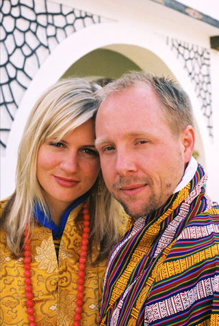 couple-in-silk-robes-at-bhutan-wedding-ceremony