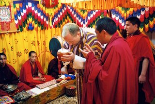 groom-bows-down-during-traditional-buddhist-wedding