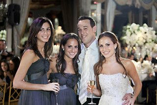 twin-sisters-and-groom-with-champagne