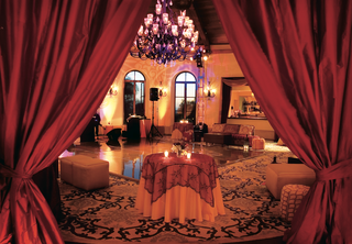 red-linens-and-dance-floor-with-large-chandelier