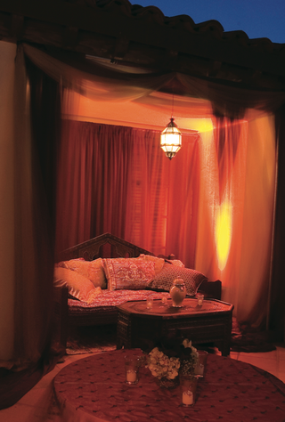 reception-lounge-area-with-daybed-pillows-and-moroccan-lanterns