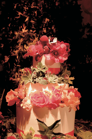 white-cake-with-pink-orange-and-green-flowers-and-star-wars-toppers