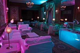 purple-and-blue-lights-illuminate-white-couches