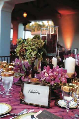 purple-tablecloths-with-orchid-centerpiece-and-gold-rimmed-glasses