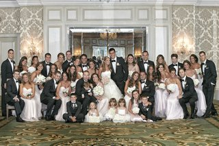 couple-with-bridesmaids-groomsmen-and-children