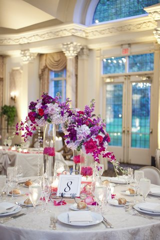 wedding-reception-at-the-grand-ballroom-of-pleasantdale-chateau-with-table-number-on-metal-curved-ea