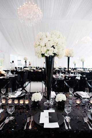 black-sequin-tablecloth-with-tall-black-centerpiece-and-white-flowers