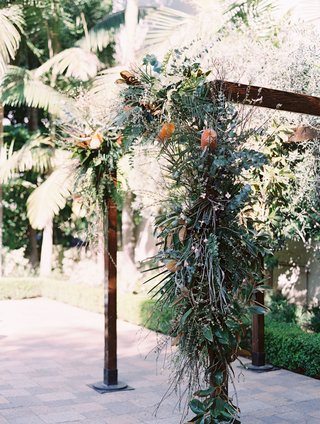 wedding-ceremony-decor-outdoor-jewish-wedding-wood-arbor-with-organic-greenery-leaves-asymmetrical