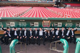 groom-with-groomsmen-and-ring-bearers-in-dugout-at-busch-stadium-in-st-louis-missouri-baseball-mlb