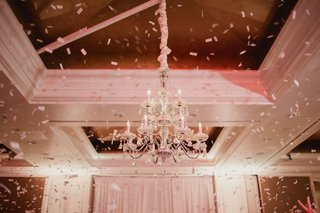 wedding-reception-ballroom-chandelier-with-confetti