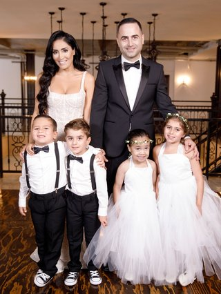 bride-and-groom-with-two-ring-bearers-in-converse-sneakers-suspender-bow-tie-flower-girls-in-tulle