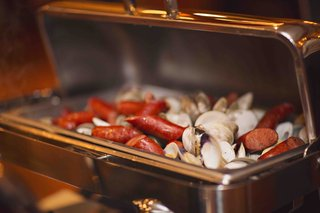 silver-buffet-tray-with-sausage-and-clams-for-rehearsal-dinner