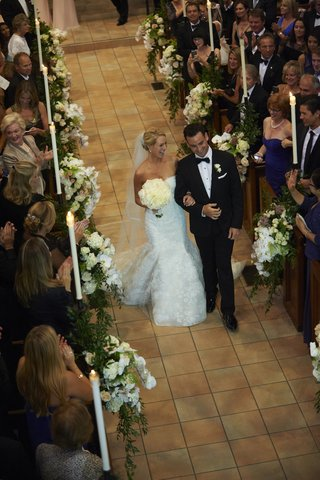 bride-and-groom-recessional-up-church-aisle