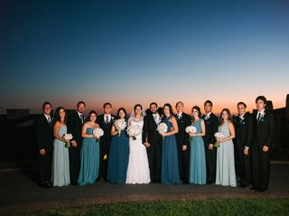 bridesmaids-in-mismatched-blue-bridesmaid-dresses-with-groomsmen-in-suits-at-sunset-terranea-resort