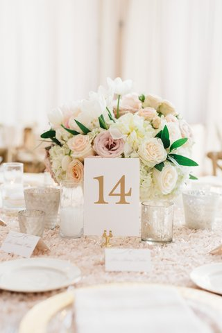 low-flower-arrangement-of-pink-and-white-roses-white-tulip-flowers-textured-linen-gold-table-number