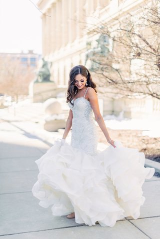 brooke-squires-in-mermaid-wedding-dress-allure-bridals-ruffle-skirt-long-hair-worn-down-curls