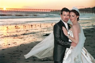 bride-in-baroque-dress-and-groom-on-beach