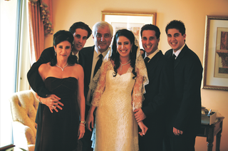 bride-in-a-liancarlo-lace-dress-and-mantilla-veil-with-her-family-in-black-attire