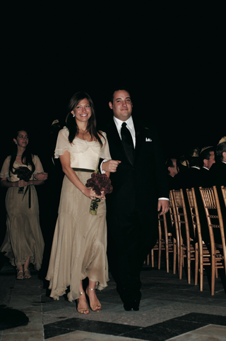 bridesmaid-in-long-dress-with-white-top-and-tan-skirt-with-groomsman-in-black-tuxedo-and-tie