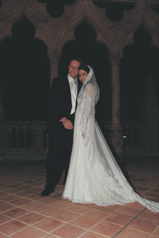 bride-in-a-liancarlo-lace-dress-and-mantilla-veil-with-groom-in-a-black-tuxedo-and-striped-tie
