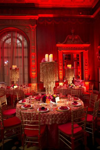 gold-beaded-chandelier-centerpiece-and-red-lighting