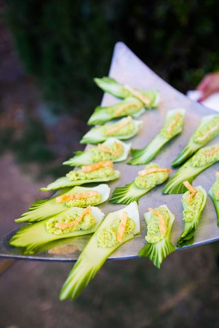 small-veggie-based-hors-doeuvres-served-as-part-of-an-israeli-farm-to-table-reception-menu
