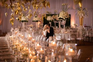bride-and-groom-alone-in-wedding-reception-space-with-classic-white-and-gold-colors