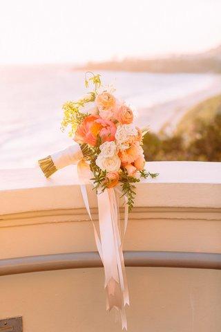 sunset-photo-of-bridal-bouquet-hot-pink-peony-white-orange-roses-ranunculus-greenery