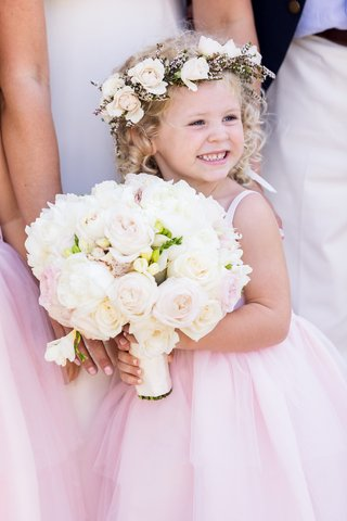 adorable-flower-girl-in-pink-dress-with-flower-crown-and-bridal-bouquet