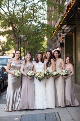 bride-in-lace-wedding-dress-from-mark-ingram-atelier-with-champagne-pink-pale-purple-taupe-dresses
