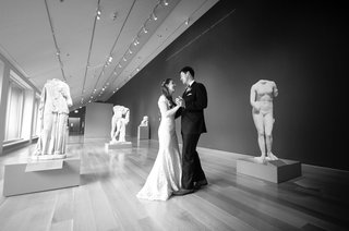 black-and-white-photo-of-bride-and-groom-in-room-with-statues-art-institute-of-chicago-wood-floor