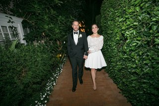 bride-and-groom-getting-ready-for-after-party-second-dress-rime-arodaky-above-knee